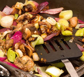 Mushrooms, Leeks and red onions frying in a pan — Stock Photo