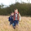 Brothers in a country field in the winter — Stock Photo