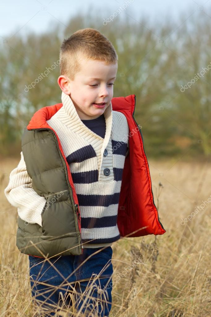 Boy in a country field in the winter — Stock Photo #18244551