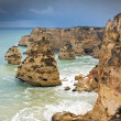 Стоковое фото: Storm clouds gather around cliffs at beach