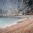 Stock Photo: Beach cove on overcast grey day