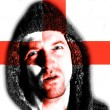 Hooded angry man with English flag design on face — Stock Photo