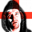 Hooded angry man with English flag design on face — Stock Photo #20860331