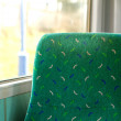 Empty seat by the window on a train carrige - Stock Photo