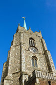 Top of churtch tower against a blue sky — Stock Photo