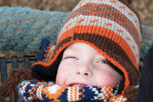 Happy young boy playing at the park on a cold day — Stock Photo