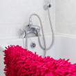 White bathroom with red towels — Stock Photo