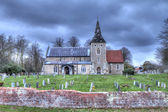 Church and graveyard at dusk — Stock Photo