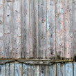 Rotting wooden panels crumbling with decay — Stock Photo