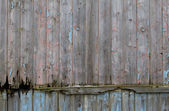 Rotting green wooden panels crumbling with decay — Stock Photo