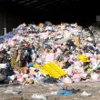 Rubbish piled up at a waste management centre — Stock Photo #23452476