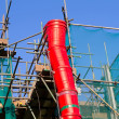 Scaffolding complete with rubbish waste chute — Stock Photo