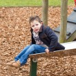 Little boy playing a a park on a cold morning - Stock Photo