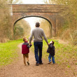 Stock Photo: Children walking with their father