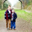 Brothers standing together on a country path — Stock Photo #24505985
