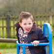 Happy little boy playing at the park — Stock Photo