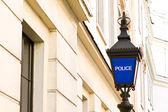 View of traditional police station lamp in England — Stock Photo