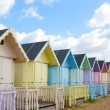 Traditional British beach huts on a bright sunny day — Stock Photo #24851263