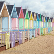 Traditional British beach huts on a bright sunny day — Stock Photo #24851279