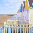 Traditional British beach huts on a bright sunny day — Stock Photo