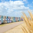 Traditional British beach huts on a bright sunny day — Stock Photo #24851469