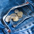 Royalty-Free Stock Photo: UK coins falling out of jeans pocket