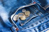 UK coins falling out of jeans pocket — Stock Photo