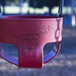 Royalty-Free Stock Photo: A red childs swing