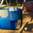 Royalty-Free Stock Photo: A blue childs swing