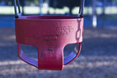 A red childs swing — Stock Photo