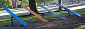 Multi colored teeter totter — Stock Photo