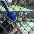 A teen boy at a batting cage — Stock Photo