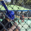 A teen boy at a batting cage — Stock Photo #12855484