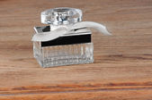 Perfume bottle on the table — Stock Photo