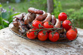 Chicken sausages and pork ribs — Stock Photo