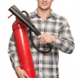 Man with extinguisher — Stock Photo