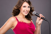 Teenager with microphone — Stock Photo