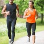 Sport couple running — Stock Photo #26933295