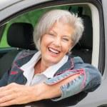 Senior woman in car — Stock Photo #27692175
