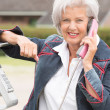Senior woman at phone — Stock Photo #27692195