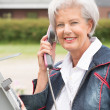 Senior woman at phone — Stock Photo