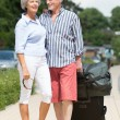 Senior couple with luggage — Stockfoto #27692363