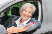 Senior woman in car — Stock Photo