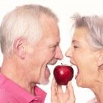 Senior couple with apple — Stock Photo #41917095