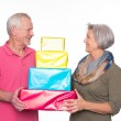 Senior couple with presents — Stock Photo