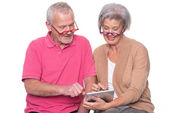 Senior couple with tablet  — Foto Stock