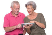 Senior couple with tablet  — Stock Photo