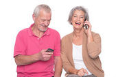 Senior couple with smartphone — Stock Photo