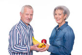 Senior couple with food — Stock Photo
