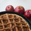 Freshly baked apple pie with apples — Stock Photo